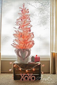 Pink Valentine Tree with heart ornaments!  I'm totally going to borrow Adelle's pink Christmas tree and set it up for February. XO