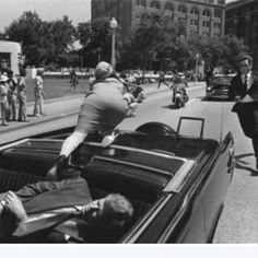 I had never seen this photo before. Jackie Kennedy reaches for help after President JFK is shot in Dallas, Texas Another article said she was actually reaching for part of his skull that had been blown off. Such a horrific scene.