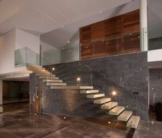 homify México: Barandales con estilo: Ideas para escaleras modernas.  #escaleras modernas http://www.homify.com.mx/habitaciones/pasillo-hall-y-escaleras