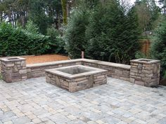fire pit, outdoor seating, outdoor living, outdoor fireplace, covered patio, planter boxes, square fire pit www.brownbrosmasonry.net
