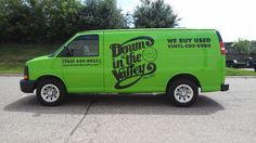 Bold, black graphics on a bright green van will definitely  draw attention for this local record store!