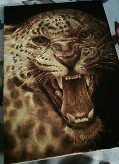 """Cheetah ""pyrography on poplar wood, Andrea Cabras."