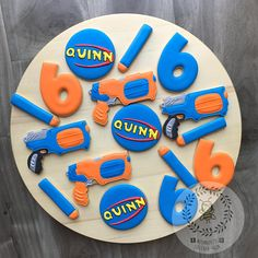 This listing is for 14 cookies, including: 4 guns 3 names 4 numbers 5 bullets Please mention which color set would you like in the note when you check out Each cookie is packed individually in cello bag. Ingredients: unsalted butter, sugar, eggs, vanilla paste, all-purpose flour, salt.