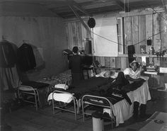 Japanese-American couple in bleak barracks quarters at the Salinas, California assembly center in March 1942. From this initial detention facility the would be transferred to one of ten internment camps for the duration of World War II. March 1942. Dangerous times lead to poor decisions at times.
