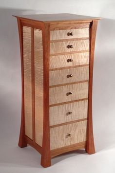 """Lingerie chest made from solid heart cherry and curly maple. Drawers and drawer frames are made from solid hard maple. All joinery is mortise and tenon with fully dovetailed drawers, front and back. Natural finish is a hand rubbed tung oil varnish. 23""""w X 22""""d X 49""""h"""