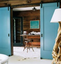 i love barn doors! i'd love to have them separate a camera room from a viewing room. i love the rustic walls. actually yeah, i would like to just mimic every detail!