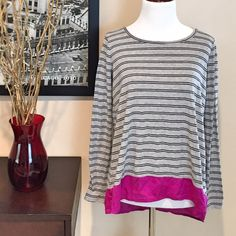 Michael Stars Long Sleeve Stripe Tee Cute Michael Stars Long Sleeve Stripe Tee. Gray t-shirt that is 80% rayon, 15% polyester, and 5% spandex. Has black stripes. Bottom contrast is magenta and 100% silk. Hi-lo hemline. Really great shirt and looks cute paired with black jeans and flats. OSFM. Excellent condition! Michael Stars Tops