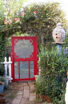 Great idea~ Paint a screen door a bright color and use it as a garden gate! I like the birdhouse