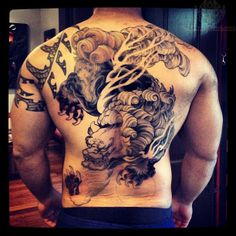 fa1498a904af2 What does fu dog tattoo mean? We have fu dog tattoo ideas, designs,  symbolism and we explain the meaning behind the tattoo.