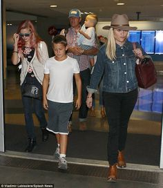 Reese Witherspoon looks ready for summer as she carries a floral printed bag while arriving at LAX | Daily Mail Online