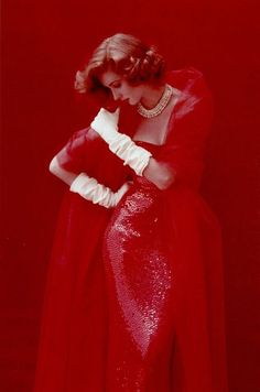 Suzy Parker is really the lady in red in this photo. Love it--vintage yet so-today.
