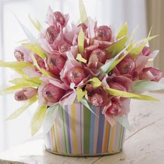 Assemble edible flowers made from chocolate eggs, tissue paper, and skewers into a box or vase for a lovely and tasty centerpiece. #Easter