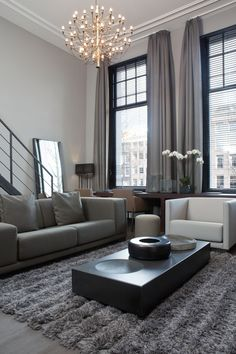 What's gray, tall, and chic all over? This living room! Not only does the color choice do wonders for this space, but the chandelier is the perfect add!