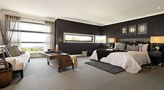 The Sorrento boasts a sophisticated master suite displaying layering of textures in blacks, golds and linens (featured materials include black textured seagrass wallpaper, taupe and black loop pile carpet and luxurious layered linen).