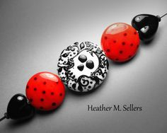 Rockabilly Chic, a lampwork glass bead set by Heather Sellers #rockabilly #rock #tattoo #lampwork #skull