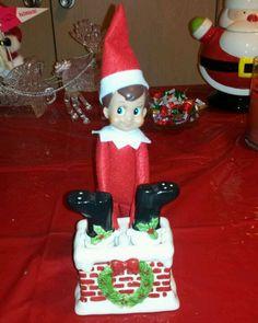 Is he pushing or helping Santa?