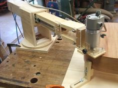 Binding Router Jig by Localele -- Homemade binding router jig constructed from wood, plexiglass, drawer slides, and hardware. http://www.homemadetools.net/homemade-binding-router-jig-4