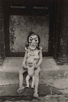 Young girl with Old Bag mask & Child Doll