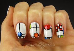 Frank Lloyd Wright inspired nail art featuring OPI My Boyfriend Scales Walls, China Glaze Blue Sparrow, Venique Galoshes Glow, OPI Animal-istic, Essie Capri, China Glaze Luxe and Lush,  Sinful Colors Pearl Harbor, Finger Paints Flecked, OPI I Lily Love You, Sinful Colors UFO