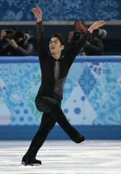 Daisuke Takahashi of Japan competes in the men's short program figure skating competition at the Iceberg Skating Palace during the 2014 Wint...