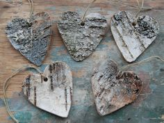 If you have a piece of birch bark that you're no longer using on a nature table, cut out bark heart ornaments - for Christmas or Valentine's day.