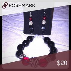 Animal Print Bracelet & earrings set Beautiful earrings and bracelet set. Bracelet  made with black glass pearls, ruby red faceted glass beads and one zebra print center bead, earrings made with check glAss beads and Silvertone round beads Jewelry Bracelets