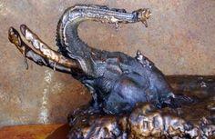Bronze Wild Animals and Wild Life sculpture by artist Michael J Mawdsley titled: 'Mudbath (bronze Head Bust of Elephant in Mud statue)'