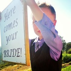 Love how he walked down the aisle holding the sign in front of his face!