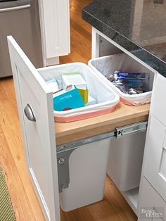 A pullout under the peninsula holds two bins for sorting recyclables. Its location allows easy access without entering the work zone. /