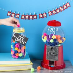 Celebrate the 100th day of school with a fun project the whole classroom can enjoy! 1) Apply stickers to a chalkboard tag and the globe of a gumball machine. 2) Tie the tag around a mason jar and finish with school-themed ribbon. 3) Fill the gumball machine with pom-poms and you're ready to start the countdown!