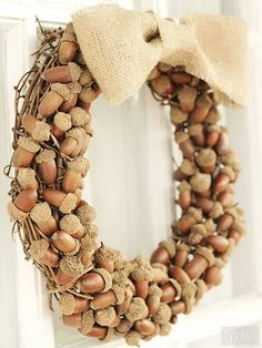 Make a sweet fall statement with this natural harvest wreath. Start by hot-gluing acorns to a grapevine wreath. It's helpful if you hot-glue the caps on first; plan for around 100 acorns to get a full look. Add a handmade burlap bow to the top of the wreath. For a touch of glamour, add a dusting of metallic gold glitter./