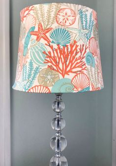 Lampshades made with a variety of coastal fabrics. Featured on Completely Coastal. Renew a lamp with a coastal lampshade! Coastal Fabric, Coastal Style, Coastal Decor, Coastal Nursery, Coastal Lighting, Nautical Lamp Shades, Nautical Lamps, Nautical Rope, Fabric Lampshade