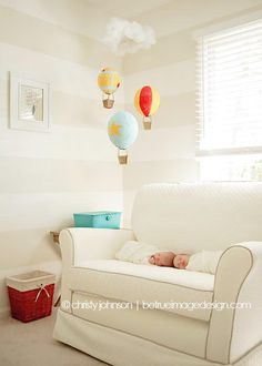 love this chair and a half for the twins' room!  oooh, and the horizontal stripes in cream, too!! lifestyle newborn photos | hot air balloon nursery decor | betrueimagedesign.com