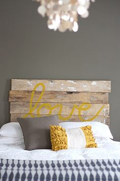 Must try this headboard! Yellow and grey master bedroom with distressed wood headboard. Not sold on the headboard but love the grey with pops of yellow for a master bedroom! House Tweaking, Decor, Home Diy, Wooden Diy, Diy Headboard, Bed Pillows, Interior, Bedroom Decor, Home Decor