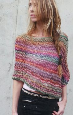 Pink red orange beige and green mix poncho wrap This poncho is so incredibly soft made from a mix of 60% Wool, 40% Acrylic, its light weight, warm, and
