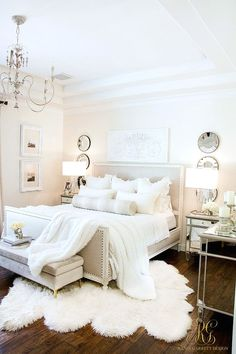 White master bedroom with blue velvet pillows and antelope bolster pillow. Headboard with nailhead trim, antique chandelier from New Orleans. Soothing Summer Home Tour 2017 - Neutral Transitional Home Decor Glam Bedroom, Shabby Chic Bedrooms, Home Decor Bedroom, White Bedroom Suite, Cozy White Bedroom, Diy Bedroom, Adult Bedroom Ideas, Attic Master Bedroom, Bedroom Rustic