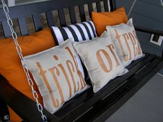 I love the orange and black and white striped pillows - classy halloween