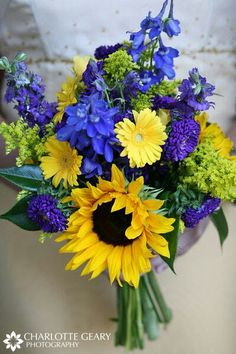 Wedding Bouquet With: Blue Delphinium, Purple/Yellow Zinnias, Yellow Gerber Daisies, Yellow Sunflowers, Greenery/Foliage