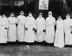 """Doctors Wear Surgical Gowns and Masks - U80057INP - Rights Managed - Stock Photo - Corbis. Doctors, army officers, and reporters wear surgical gowns and masks while making a tour of a hospital to observe Spanish influenza treatment of patients. The poster by E.M. Ashe behind them reads, """"Buy Bonds to Your Utmost."""""""