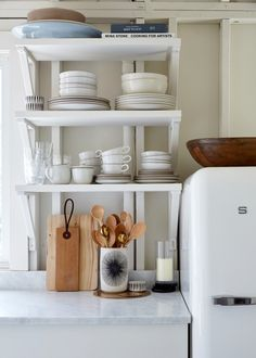 open shelving in this tiny beach cottage kitchen still loads up plenty of minimal style | via coco kelley