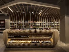 Spar's supermarket Budapest's upscale MOM Park defies the design norms of a supermarket, instead making the store a retail destination. Centre Commercial, Commercial Design, Commercial Interiors, Wine Shop Interior, Retail Interior, Retail Store Design, Retail Shop, Design Comercial, Rack Design
