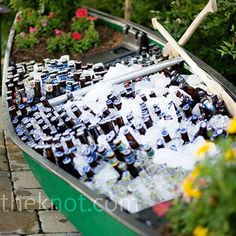 canoe used as a beverage station!  particularly like the flower beds inside it so the canoe doesn't look empty