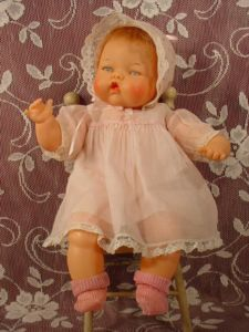 Thumbelina Doll - She slowly moved her head from side to side when you'd wind the knob on her back.
