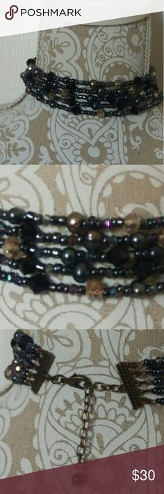 """Multi Strand Black Choker (NWOT) This beautiful piece is one of a kind multi strand choker, each one hand-arrayed in a non-repeating pattern using black bicone crystal, plum micro crystalline, champagne rondelle crystal, iridescent black fresh water pearl (potato shape), hematite color glass pearl and hematite color glass seed beads with a brass clasp and 2"""" extender. Perfect for the upcoming holidays! Jewelry Necklaces"""