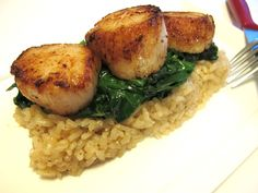 delicious seared scallops and parmesan risotto with wilted spinach recipe with step by step photo instructions!