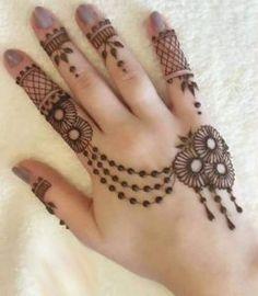 Cute Back Hand Mehndi ..I like just the pinky design