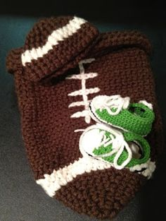 Football Cocoon and cute little Converse shoes: Free crochet patterns I need someone to have a baby boy just so I can make this!!! lol