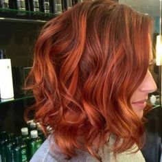 Balayage can make a beautiful multidimensional red. Painting Different tones of the same base gives an extra edge to any hair color.