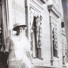 "Grand Duchess Maria Nikolaevna Romanov of Russia sitting on a ledge at Lower Dacha at Peterhof. ""AL"""