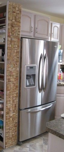 """How cool are the wine cork """"tiles""""? Could see this as a countertop backsplash!"""